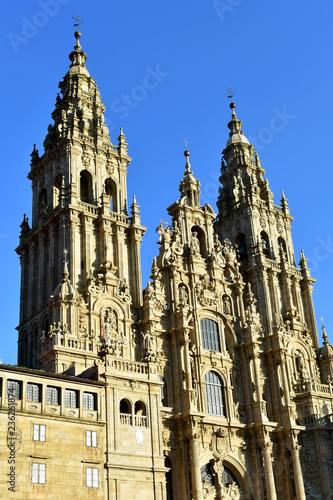 Cathedral with sunset light and clean stone. Obradoiro Square, baroque facade and towers. Santiago de Compostela, Spain.