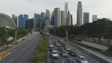 Traffic Jam On A Busy Road Of Singapore On Cityscape Background. Shot. Traffic Jam At A Highway In Singapore And Modern Buildings On Background.