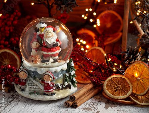 Foto op Plexiglas Kerstmis Musical Snow Globe with Santa Claus on bokeh background