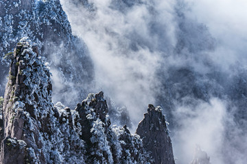 Clouds above the mountain peaks of Huangshan National park.