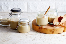 Homemade Tahini In Glass Jars (sesame Seed Paste).