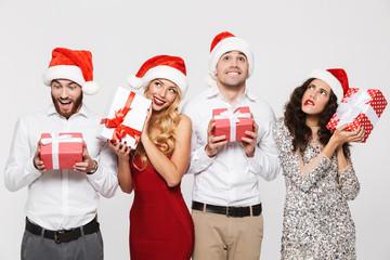 Fototapeta Group of happy friends dressed in red hats