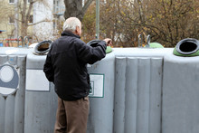 Rentner Beim Pfandflaschen Sammeln (Pensioner Collecting Deposit Bottles To Supplement Income)