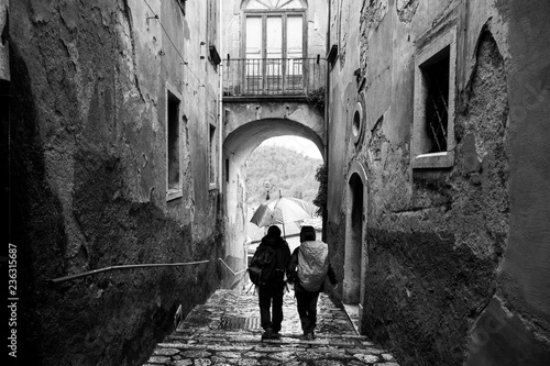 Staande foto Oude gebouw a couple walks in the alleys of Tufo, wine town Greco di Tufo, province of Avellino, Italy