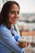Corporate Time-out. Close Up Portrait Of Young Smiling Office Woman Standing On Balcony With Cup Of Coffee. Copy Space On Right