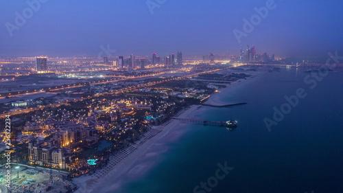 Photo  Dubai Marina Skyline night to day from Burj Al Arab
