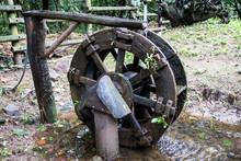 Old Wooden Waterwheel In The Forest