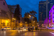 Baku, Azerbaijan - Oct 11th 2018 - Locals and tourists crossing a road at night in Baku in Azerbaijan