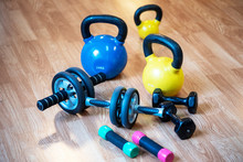 Exercise Weights - Dumbbell With Extra Plates , Kettlebells, Ab Roller Wheels On A Floor In Ygm