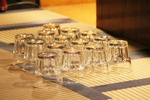 Glasses Stand Empty Upside Down. Clean Kitchenware For Drink
