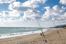 Fishing Rods On A Sandy Beach