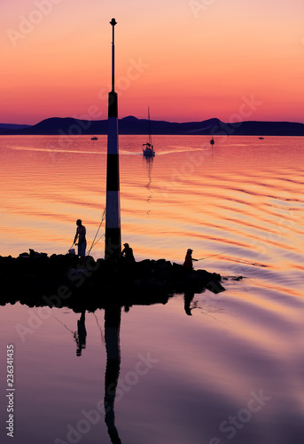 Photo  Sailing boats on Lake Balaton at sunset