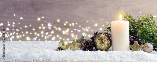 Stampa su Tela Christmas background with Advent candle and golden decoration.