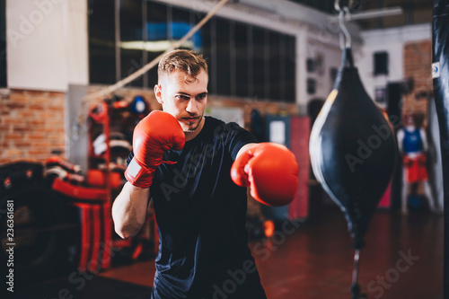 Athlete punching speed bag while practicing in gym