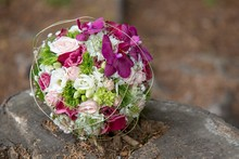 Pink And White Flowers Bouquet On Stump