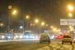 Moscow, Russia - November, 28: cars on a highway in an evening at snowstorm