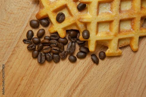 Fotografía  Tasty fresh Belgian wafers, grain coffee on a wooden background, copy space