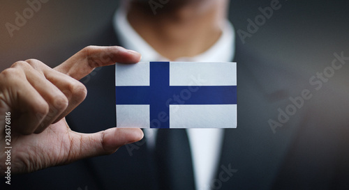Fotografia Businessman Holding Card of Finland Flag