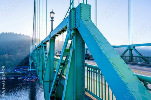 Fotografie, Obraz St Johns truss arched bridge across the Willamette river in industrial Portland
