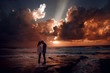 Couple in love at a fiery sunset.Silhouette photo