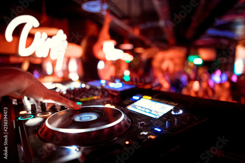 Fototapeta  Dj mixes the track in the nightclub at party