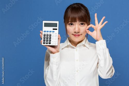 Fotografía  計算機を持つ女性