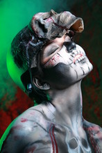 Zombie Death Girl With Scary Body Art Posing In The Night In Thesmoke Alone