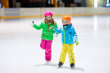 Child Skating On Indoor Ice Ri...