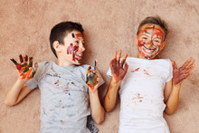 Little Cheerful Boys With Pain...