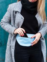 Girl With A Leather Waist Bag