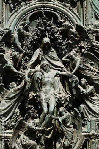 Fototapeta Lamentation of Christ, detail of the main bronze door of the Milan Cathedral, Duomo di Santa Maria Nascente, Milan, Lombardy, Italy obraz na płótnie
