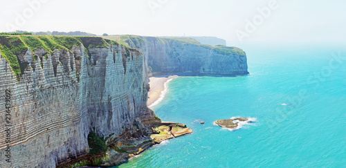 Poster Turquoise Picturesque panoramic landscape on the cliffs of Etretat. Natural cliff wonder and beach. Etretat, Normandy, France. Coast of the Pays de Caux area in sunny summer day. Low tide, ebb