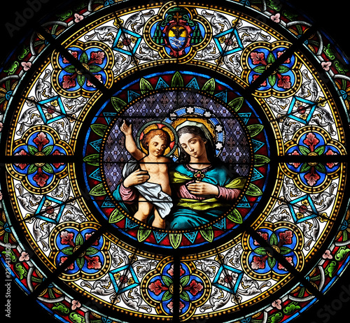 Fotografie, Obraz Virgin Mary with baby Jesus, stained glass window in the Cathedral of Saint Lawr