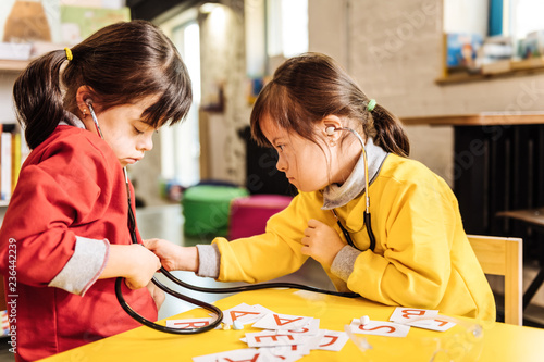 Fotografia, Obraz  Dark-haired sunny children learning letters and playing together