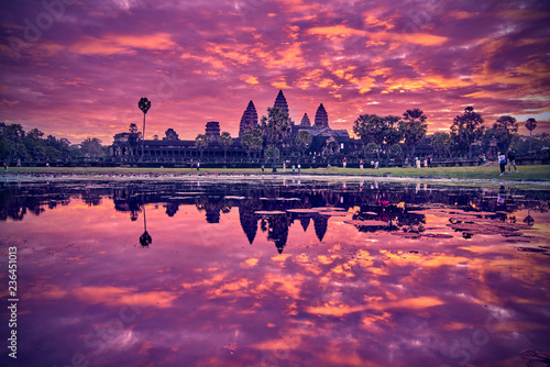 Foto auf Leinwand Altes Gebaude SIEM REAP, CAMBODIA - 13 December 2014:View of Angkor Wat complex at sunrise, Archaeological Park in Siem Reap, Cambodia, UNESCO World Heritage Site and popular tourist attraction