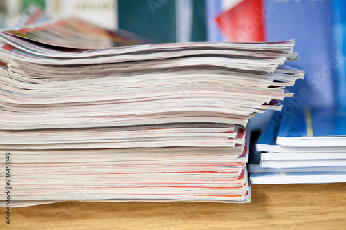 Fotografie, Obraz  a stack of newspapers library