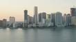 Aerial sunset view of Point View Downtown Financial District Skyscrapers Causeway bridge Metropolitan Miami Skyline Biscayne Bay Florida USA