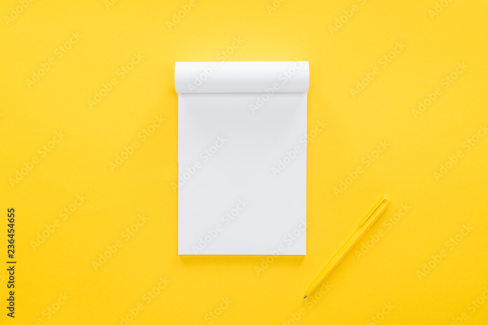 Fototapeta top view of blank notebook on yellow background