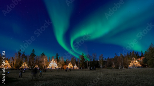 Photo sur Toile Aurore polaire Many lightup Tipi with Aurora Borealis at Yellow Knife