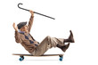 canvas print picture - Cheerful senior with a cane sitting on a longboard and riding