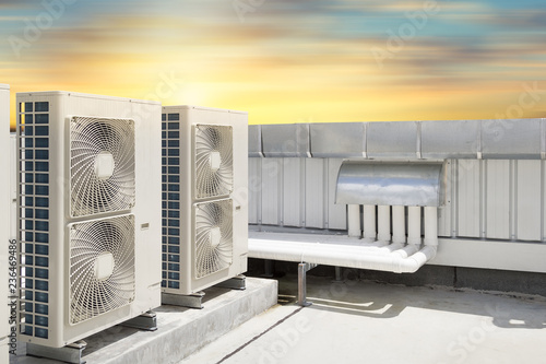 Obraz na płótnie Air compressor or air condenser unit located on roof deck building to heat released transferred to surrounding environment, Compressor is part of cooling function and air conditioning HVAC systems
