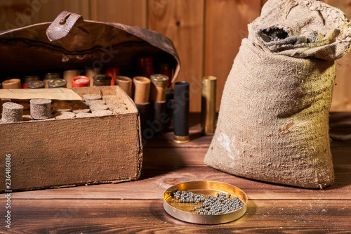 Hunting equipment for making cartridges on a wooden table