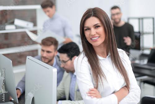 Fototapeta young employee on the background of the office obraz na płótnie