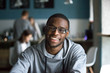 Leinwandbild Motiv Portrait of smiling African American student looking at camera sitting in cafe, black millennial man posing making picture in coffeeshop, afro male in glasses drinking coffee working in coffeehouse