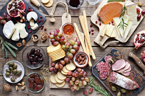 Spoed Fotobehang Voorgerecht Brunch. Appetizers table with various of cheese, curred meat, sausage, olives, nuts and fruits. Festive family or party snack concept. Overhead view.
