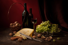 Vintage Still Life With Red Wine, Cheese, Grapes And Walnuts