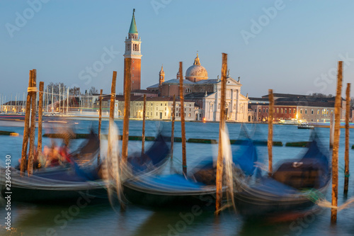 Spoed Foto op Canvas Gondolas gondolas in Venice in the background it can be seen the San Giorgio maggiore's church and Bell tower
