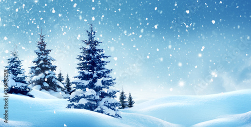 Foto auf AluDibond Blau Christmas background with snow.Winter night landscape. Happy new year greeting card with copy-space.