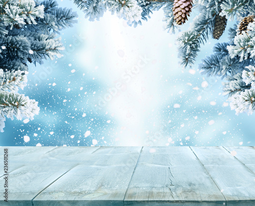 Fotobehang Lichtblauw Merry Christmas and happy New, Year greeting background with table .Winter landscape with fir tree branch