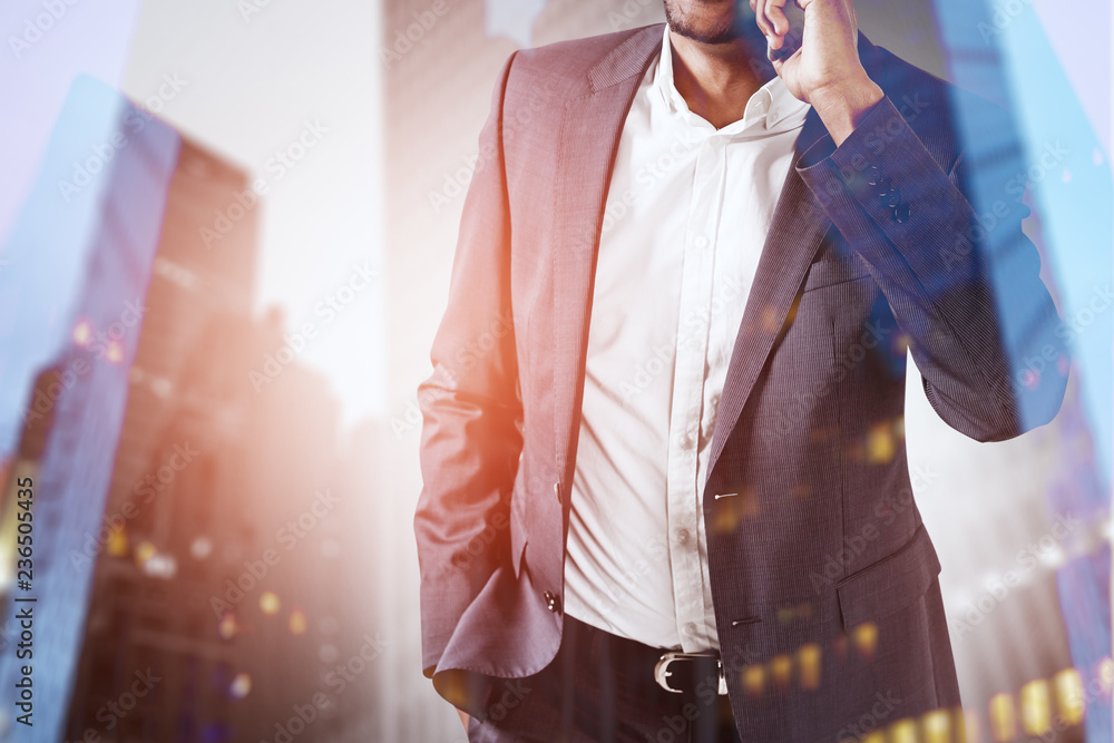 Fototapety, obrazy: African American man on phone in city